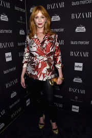 Christina Hendricks topped off her pants with a belted red and white jacket.