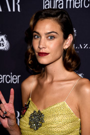 Alexa Chung glammed it up with this vintage-style curly 'do for the Harper's Bazaar Icons event.