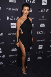 Kourtney Kardashian went the racy route in a high-slit black one-shoulder dress by Anthony Vaccarello at the Harper's Bazaar Icons event.