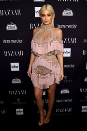 Kylie Jenner was hard to ignore in this majorly fringed and beaded mini dress by Balmain at the Harper's Bazaar Icons event.