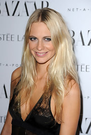 Poppy Delevigne wore her long hair casually tousled at the 2011 'Harper's Bazaar' Women of the Year Awards.