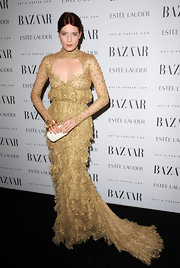 Florence Welch looked of another time period in a gorgeous olive gown made of lace tiers at the Harper's Bazaar Women of the Year Awards.