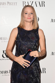 Jodie Foster paired a navy satin clutch with a beaded dress for her Harper's Bazaar Women of the Year Awards look.
