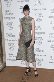 Erin O'Connor styled her dress with a pair of chunky-heeled ankle-strap peep-toes.