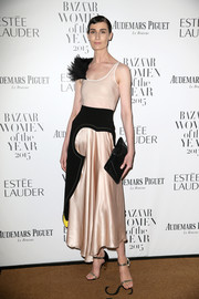 Erin O'Connor showed her unique sense of style with this fur-embellished nude and black dress at the Harper's Bazaar Women of the Year Awards.