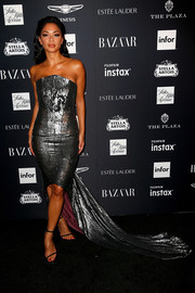 Nicole Scherzinger glimmered in a strapless silver fishtail dress at the 2018 Harper's Bazaar Icons event.