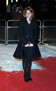 Princess Beatrice looked demure in ankle strap pumps. The maryjane style heels looked darling with an a-line wool coat.