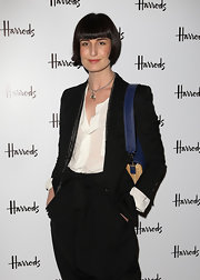 At the Harrods New Technology Department Launch, Erin O'Connor wore a black blazer with a beaded collar over a sheer white blouse.