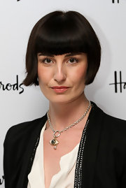 British model Erin O'Connor accessorized her outfit with a simple chain necklace with a pendant in the shape of an eye.