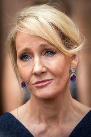 J.K. Rowling paired her 'do with purple gemstone drop earrings.