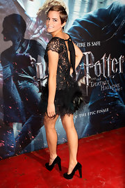 Emma Watson looked positively divine in the Charlotte Olympia Esmerelda pumps she paired with a feather and lace cocktail dress.
