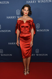 Katie Holmes looked ultra elegant in a red off-the-shoulder cocktail dress by Zac Posen at the unveiling of the Harry Winston New York Collection.