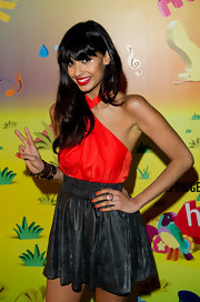 Bold blood-orange nails teamed perfectly with Jameela's bright halter top.
