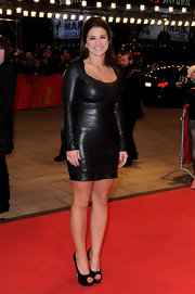 Gina Carano paired her fitted leather frock with black peep-toe pumps.