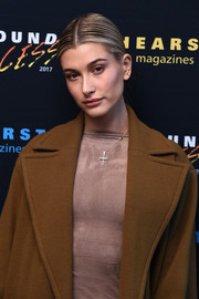 Hailey Baldwin accessorized with a delicate cross pendant at the Hearst MagFront 2016.