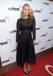 Molly Sims was all about sultry elegance in a little black dress with a see-through lace bodice at the Heart Foundation's Intimate Evening honoring Mike Meldman.