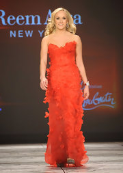 Nastia Liukin modeled a red ruffled gown at the Heart Truth 2013 Fashion Show.