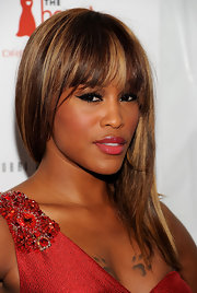 Eve wore her straight hair in a side sweep at the 2011 Heart Truth Red Dress fashion show.