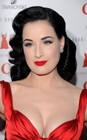 Dita Von Teese strode the runway at Heart Truth's Red Dress Fall 2011 fashion show. She pulled one side of her hair back and allowed the other side to create face-framing curls.