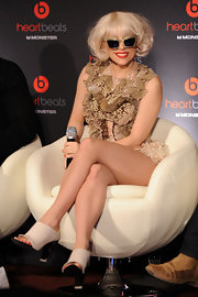 Lady Gaga wears a curled under bob.