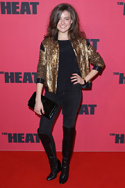 April spiced up her all-black look with this gold sequined jacket.