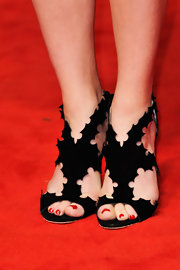 Natalie Dormer showed off her red pedicure with these black cutout pumps.