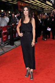 Sandra Bullock showed off her long and lean figure with this column-style black dress.