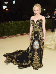 Emilia Clarke looked resplendent in a heavily embroidered strapless gown by Dolce & Gabbana Alta Moda at the 2018 Met Gala.