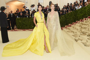 Lily Aldridge was all about cool elegance in a yellow Ralph Lauren shirtdress with a long train at the 2018 Met Gala.