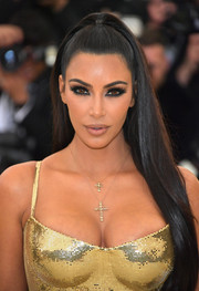 Kim Kardashian went for a goth beauty look with super smoky eyes.