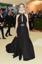 Maya Hawke turned heads in a black DVF halter gown with a ruffle neckline at the 2018 Met Gala.