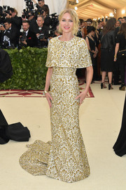 Naomi Watts was all about vintage elegance in a fully embroidered capelet-detailed gown by Michael Kors at the 2018 Met Gala.