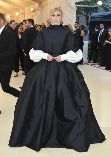 Greta Gerwig looked striking in a black The Row ball gown with contrast sleeves at the 2018 Met Gala.