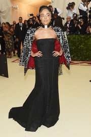 Tessa Thompson worked a strapless black corset gown by Thom Browne at the 2018 Met Gala.