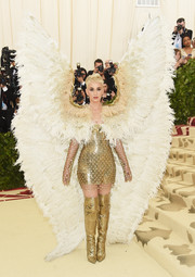All eyes were on Katy Perry as she swooped into the Met Gala dressed as a golden St. Michael the Archangel.