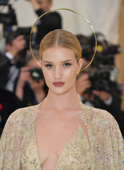 Rosie Huntington-Whiteley paired a halo headpiece with a simple center-parted updo for the 2018 Met Gala.
