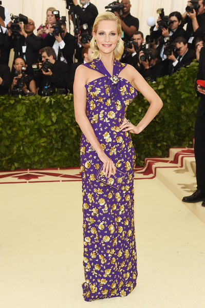 Poppy Delevingne looked enchanting in a purple Michael Kors halter gown with gold floral embellishments at the 2018 Met Gala.
