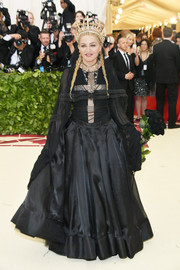 Madonna hit the 2018 Met Gala wearing a black Jean Paul Gaultier Couture bodysuit with a cross cutout.