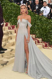 Hailey Baldwin had a princess moment at the 2018 Met Gala in a slate-blue off-the-shoulder ball gown by Tommy Hilfiger.