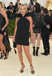 Kate Moss rocked a black Saint Laurent halter dress with feathered shoulders at the 2018 Met Gala.