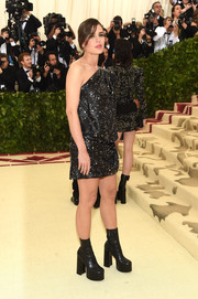 Charlotte Casiraghi was edgy-chic in a one-shoulder star-print dress by Saint Laurent at the 2018 Met Gala.