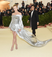 Lili Reinhart dazzled in a silver off-the-shoulder corset dress by H&M at the 2018 Met Gala.