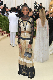 Letitia Wright was all about boho glamour in a mixed-pattern jacquard gown by Coach at the 2018 Met Gala.