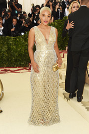 Kiersey Clemons was gilded in a beaded H&M gown with a plunging neckline at the 2018 Met Gala.