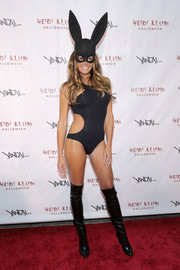 Kelly Bensimon flaunted her ageless physique in a black cutout bodysuit during Heidi Klum's Halloween party.