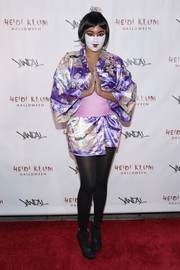 Alicia Quarles came as a geisha dressed in a short kimono during Heidi Klum's Halloween party.