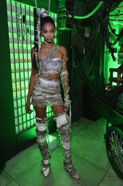 Chanel Iman completed her scary-sexy look with a pair of thigh-high boots.