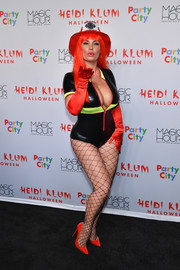 Coco turned up the heat as a firefighter in a plunging bodysuit during Heidi Klum's Halloween party.