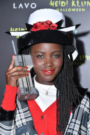 Lupita Nyong'o accessorized with a floral hat to top off her Dionne Davenport costume for Heidi Klum's 19th annual Halloween party.