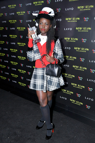 Lupita Nyong'o paired her suit with black patent Mary Janes.